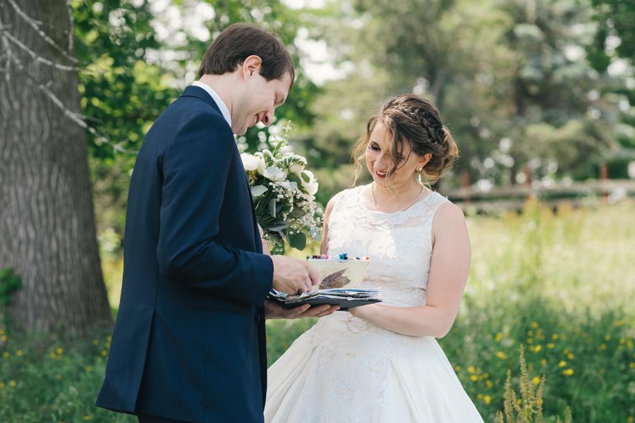 bride giving groom a handmade scrapbook gift