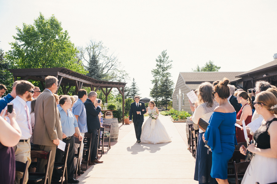 bride's father escorting her down the aisle at becker farms