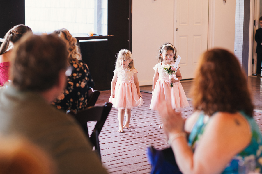 flower girls walking into reception together