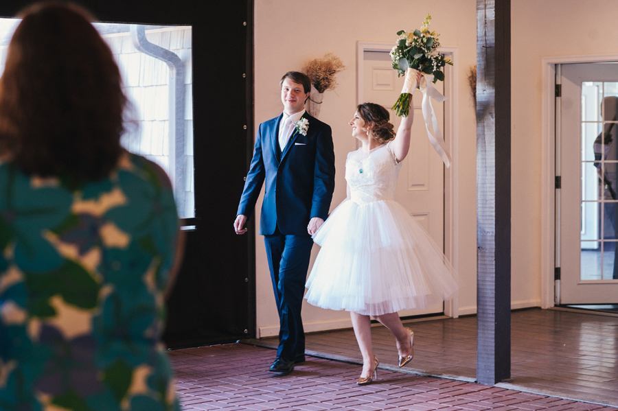 bride wearing short dress with groom for grand reception entrance