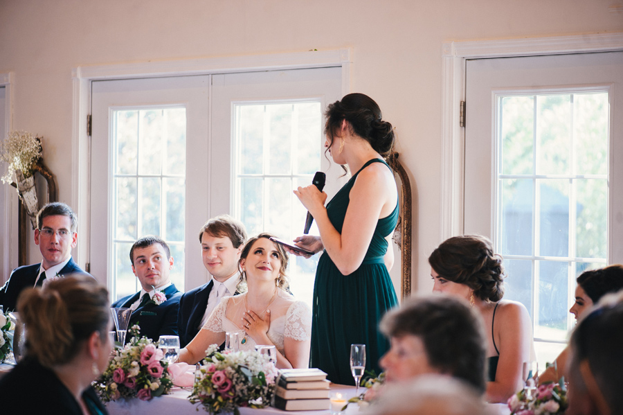 maid of honor delivering heartwarming speech to the bride