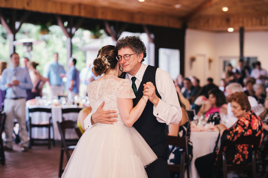 bride and father dancing together at reception