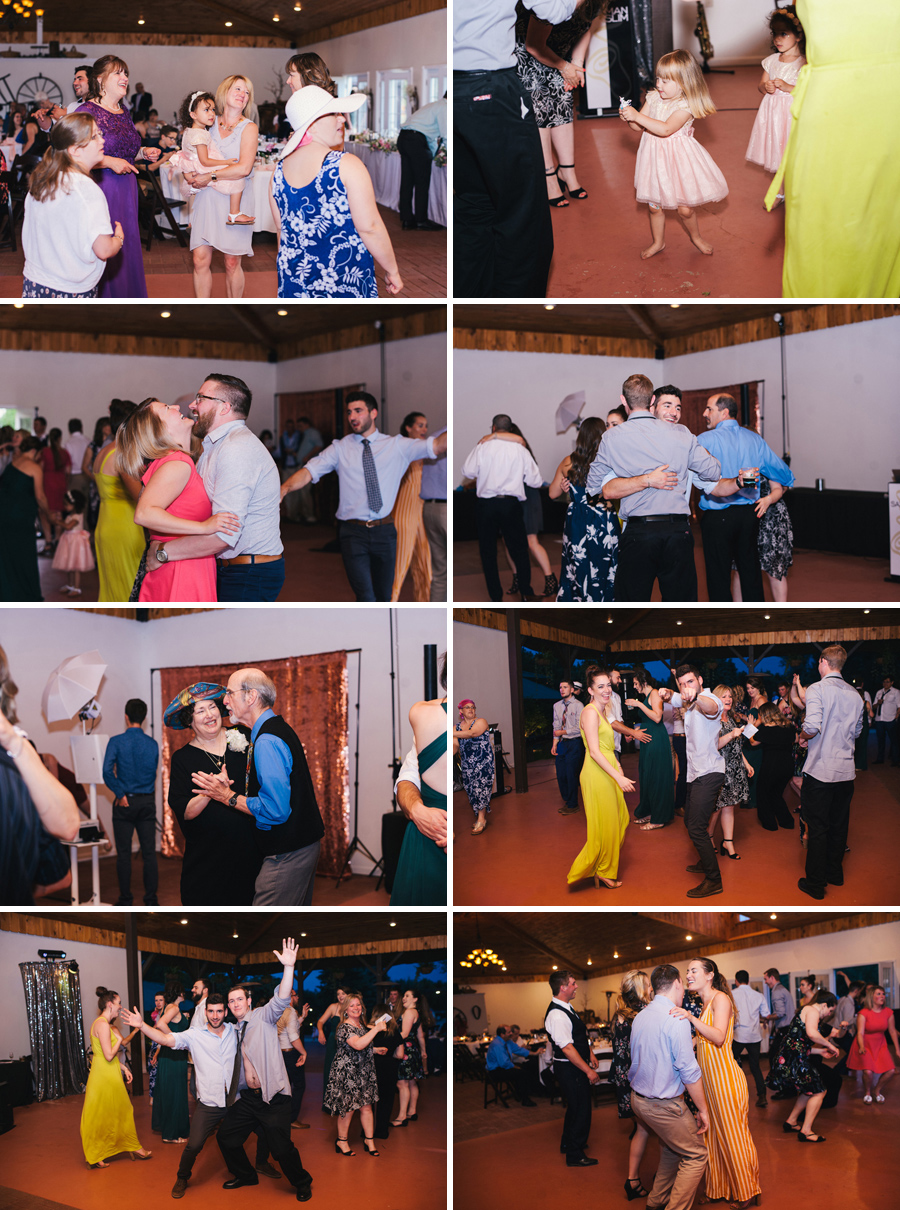wedding guests having fun on the dance floor at reception