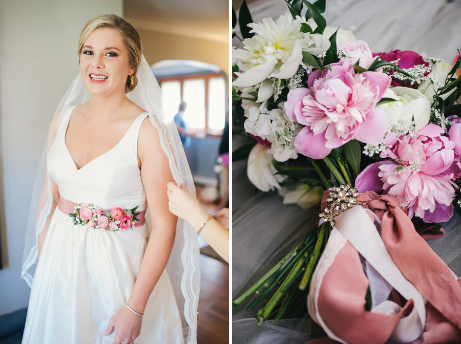 bride in wedding gown with pink flowered belt and bouquet