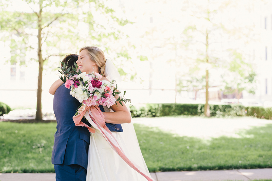 bride and groom hugging in the park