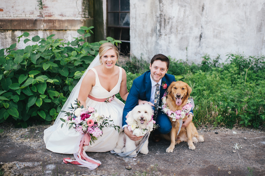 bride and groom with their dogs at silo city