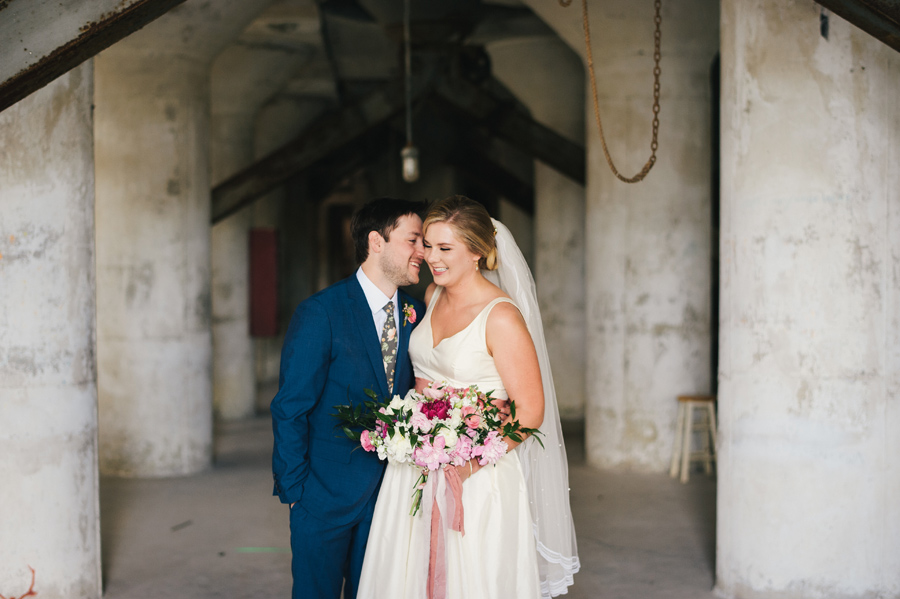 bride and groom inside the silos