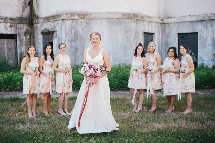 full length shot of bridal party outside of silo city