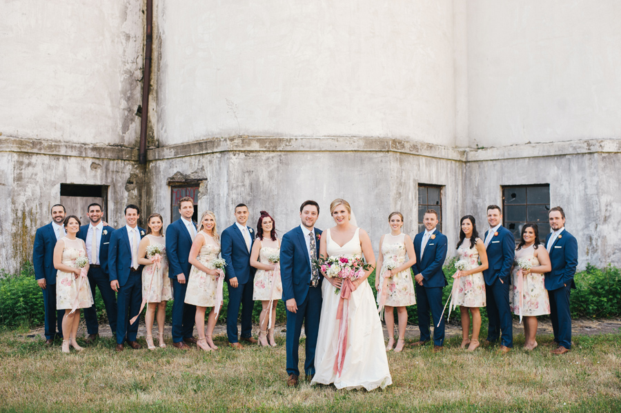 formal wedding party photo in front of silo city