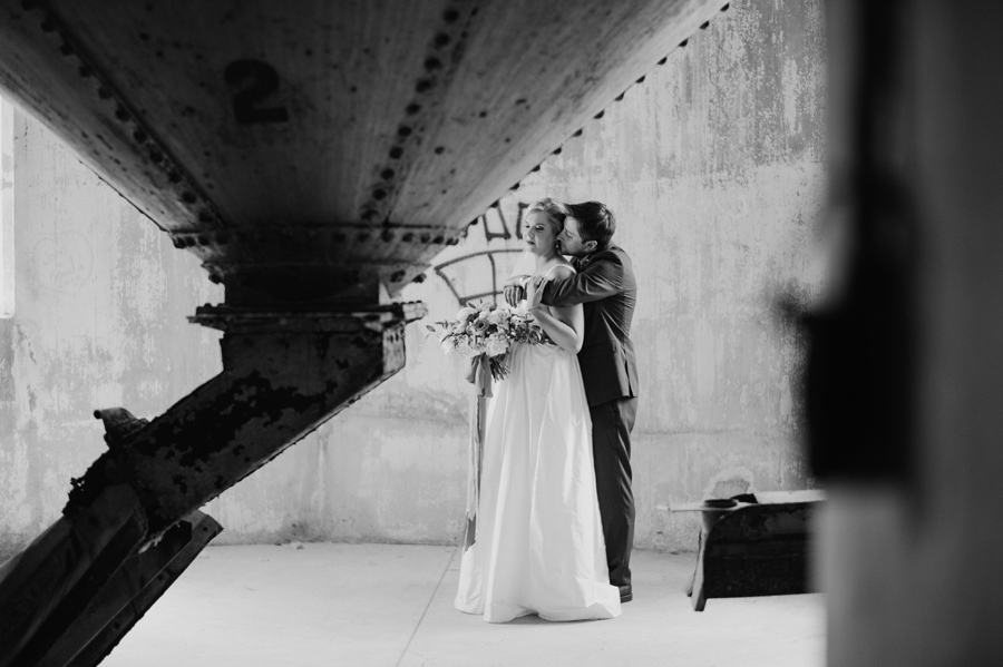 black and white photo of bride and groom inside silo city