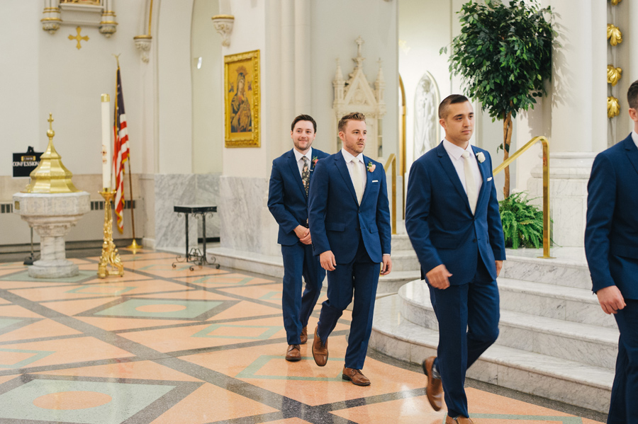 groom and groomsmen walking to the altar at st joseph cathedral