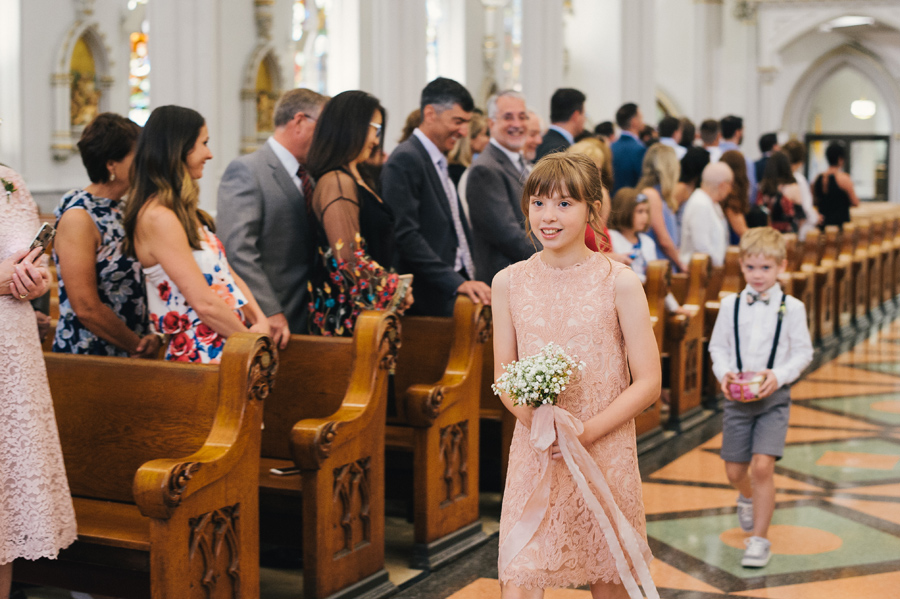 junior bridesmaid and ring bearer walking down the aisle