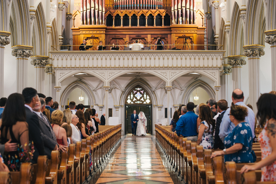 bride and her father entering the aisle at st joseph cathedral