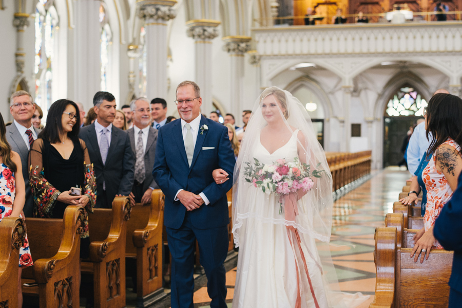 father escorting the bride down the aisle