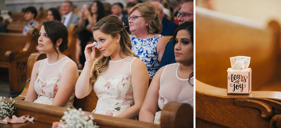 bridesmaid wiping tears with tissue box which says tears of joy