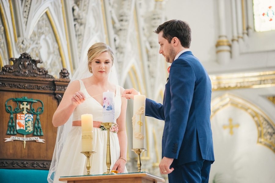 bride and groom lighting unity candles