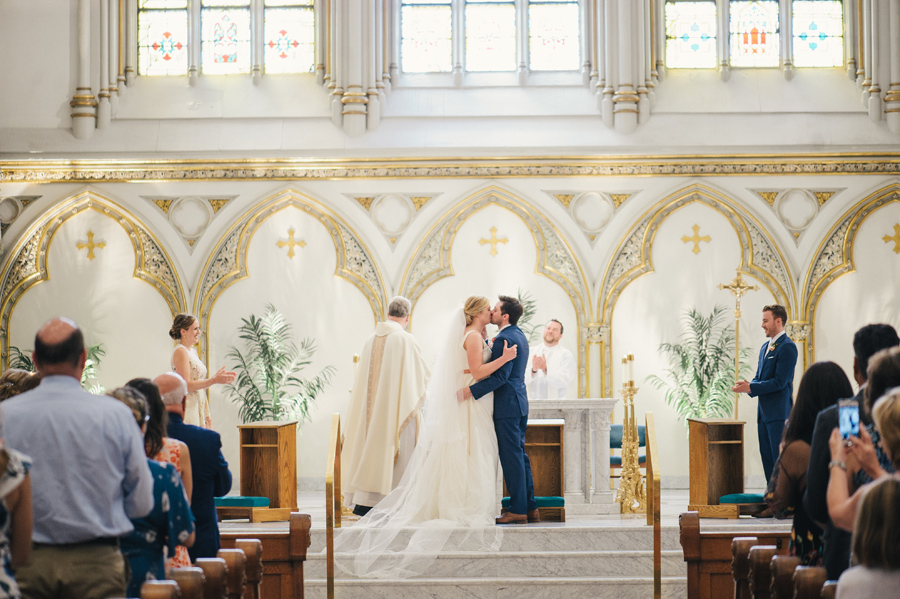 bride and groom i do kiss at st joseph cathedral