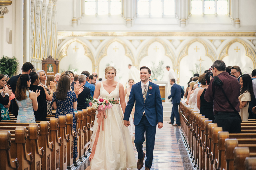 bride and groom walking up the aisle after the ceremony