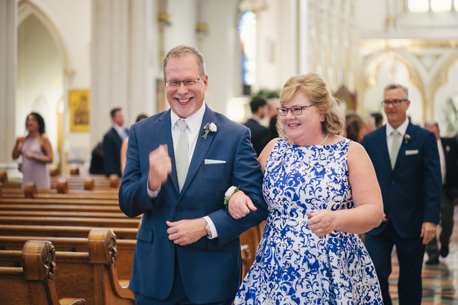 bride's parents walking up the aisle together after the ceremony