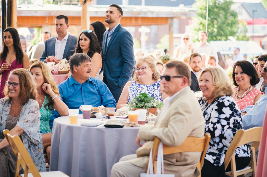 wedding guests enjoying the speeches at the reception