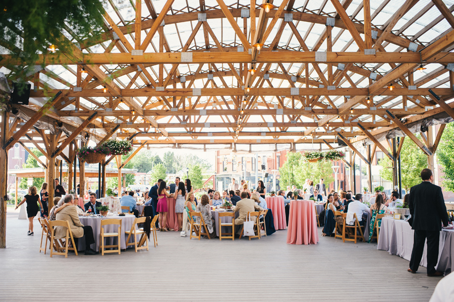 guests enjoying the reception under the larkinville pergola