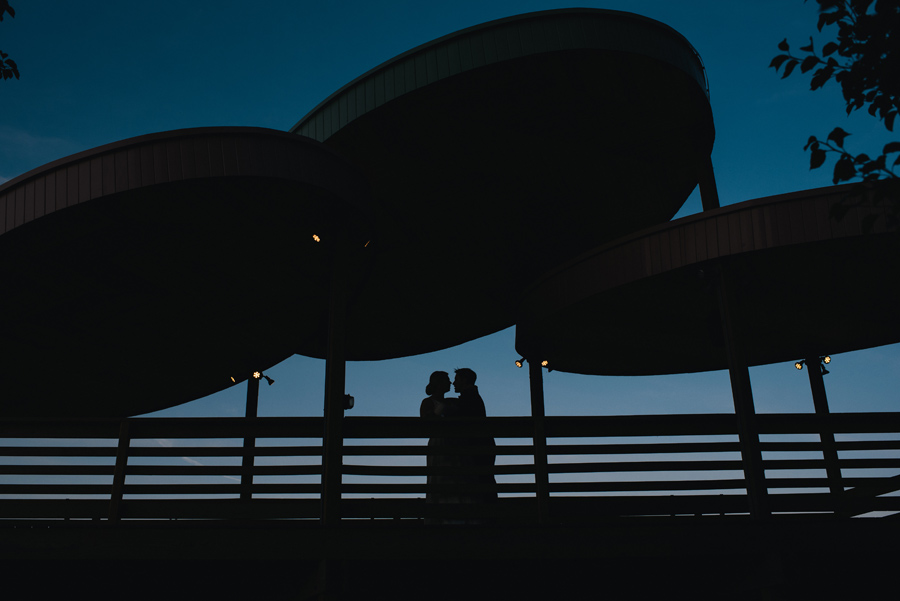 nighttime photo of bride and groom silhouette