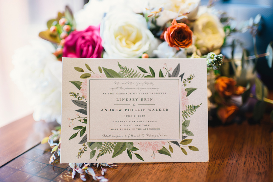 wedding invitation and bouquet close up