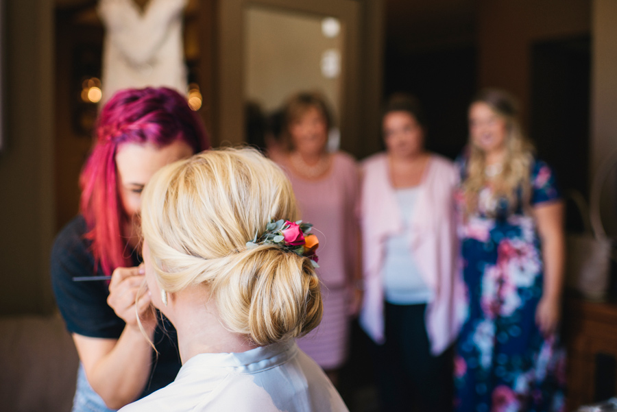 bride receiving makeup service from rachel rizzo hair and makeup