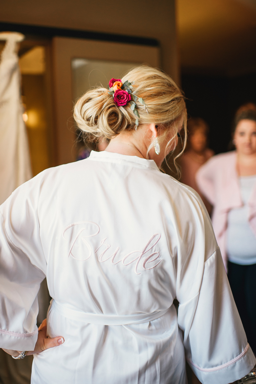 bride wearing special bridal robe while getting ready at curtiss hotel