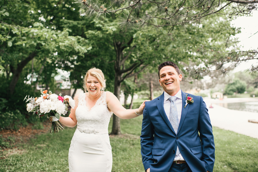 bride and groom laughing just before their first look