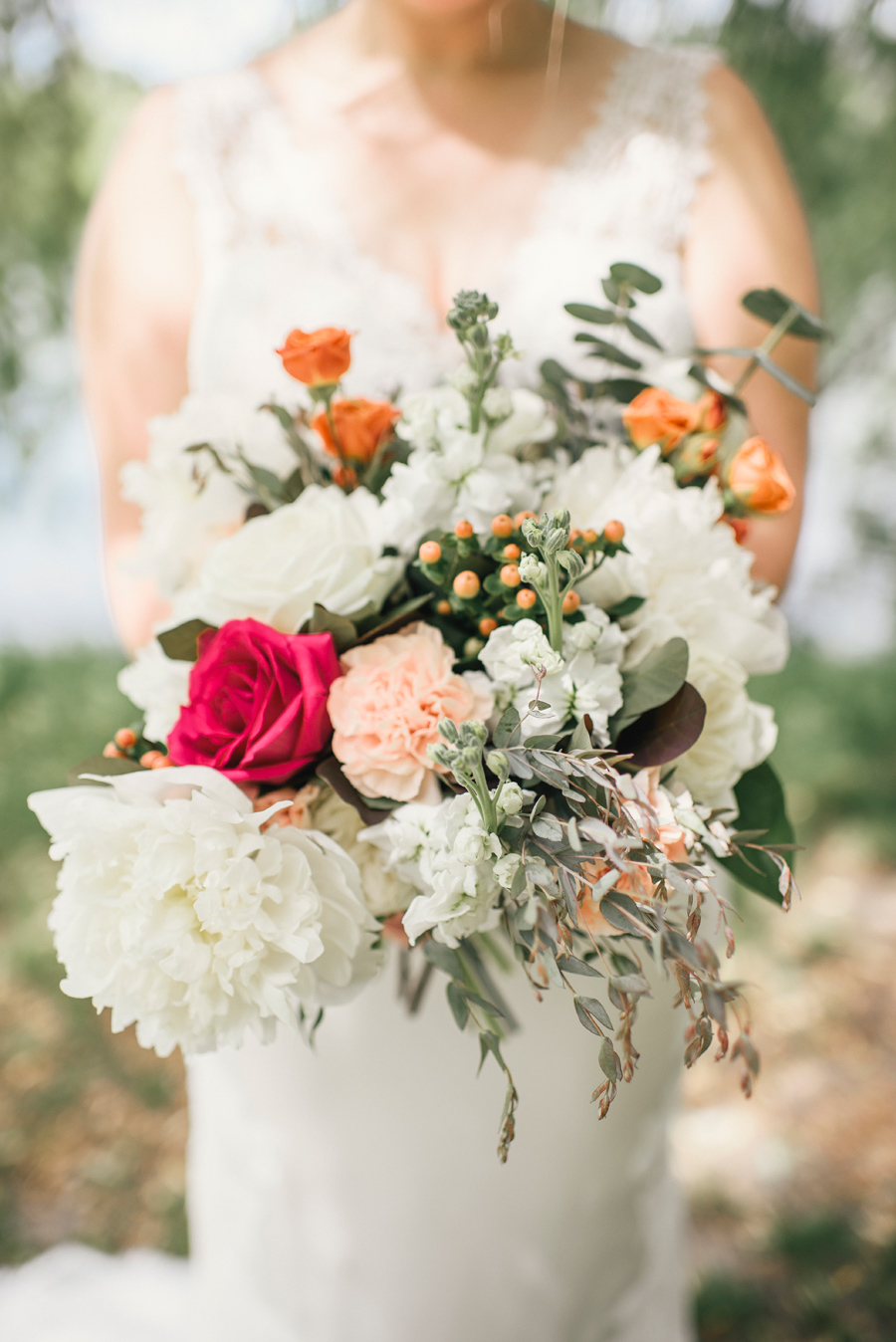 close up of bride's white hot pink and orange bouquet from williams florist