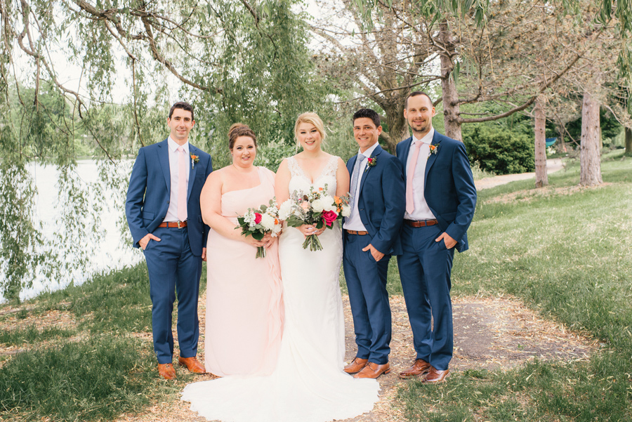 wedding party posing under a willow tree in delaware park