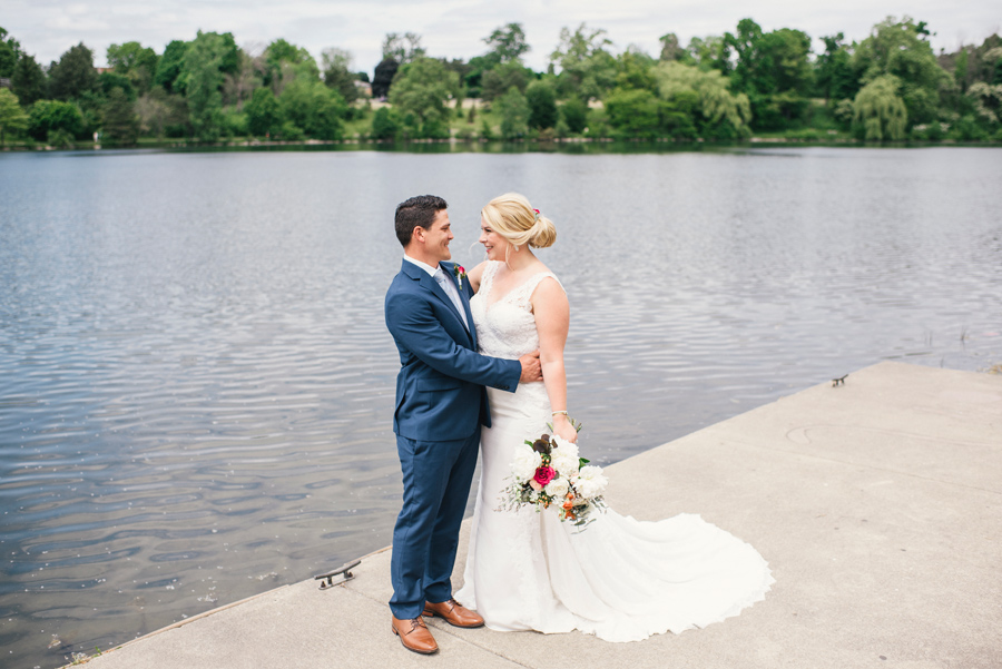 bride and groom together on the dock at hoyt lake