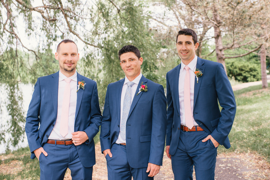 groom and his groomsmen in delaware park with blue suits