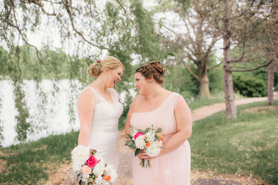 bride laughing with maid of honor in delaware park