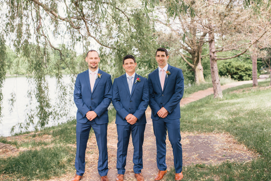 groomsmen in blue suits next to hoyt lake