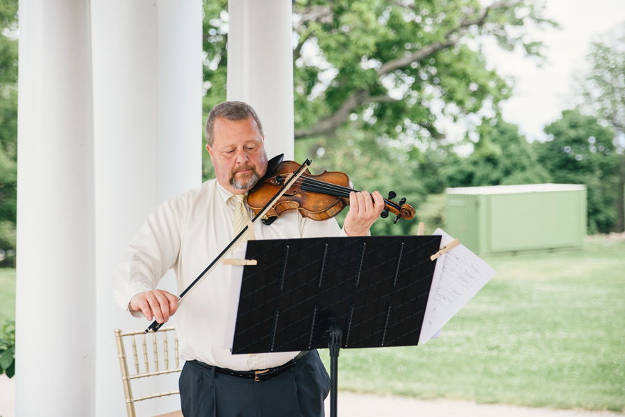 violinist from string brothers at wedding ceremony