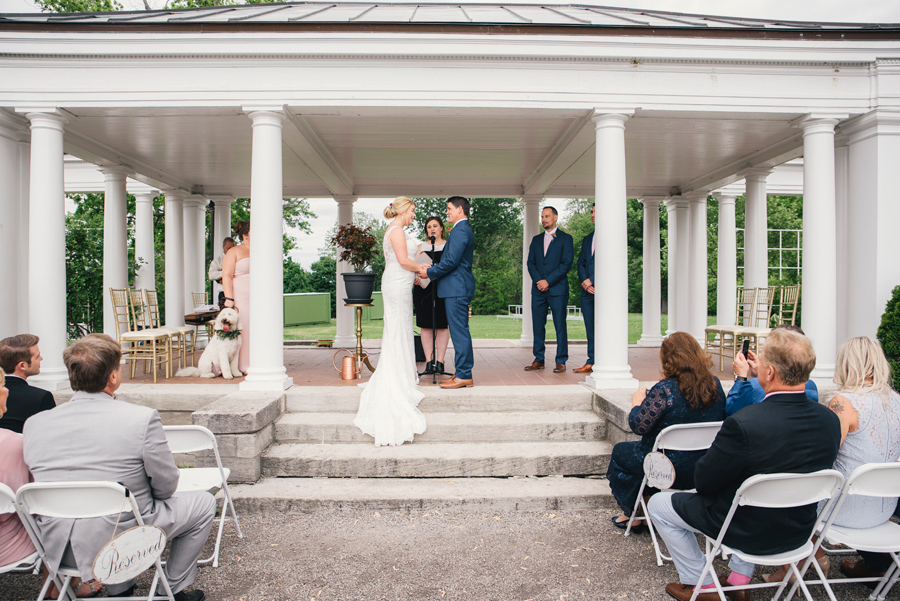 bride and groom at the altar at delaware park rose garden wedding ceremony