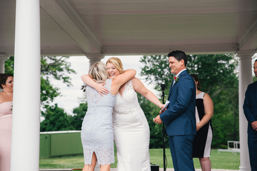 bride hugging a speech giver during the ceremony