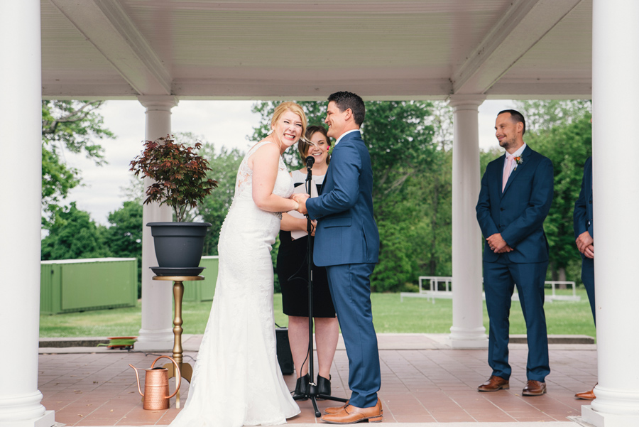 bride and groom laughing during vow exchange
