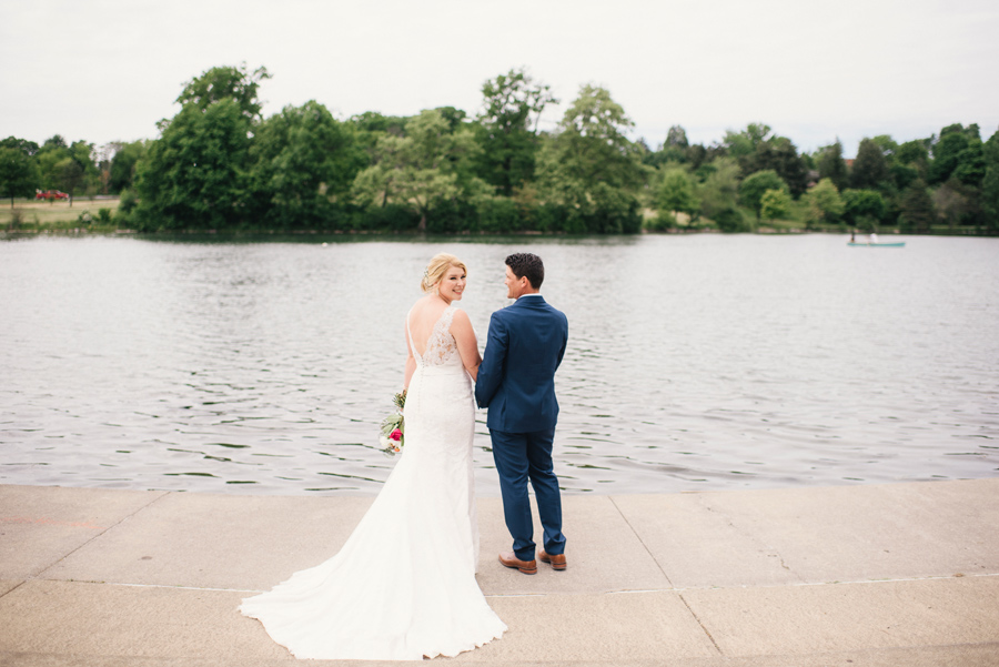 bride and groom by the water at hoyt lake