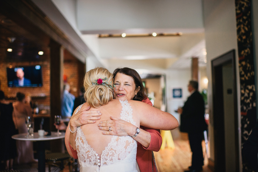 bride hugging a wedding guest at the reception