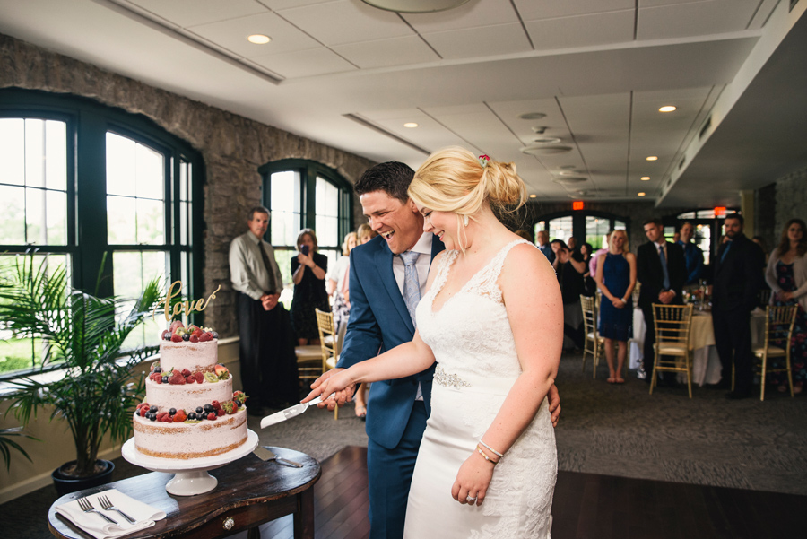 bride and groom cutting cake made by blue eyed baker