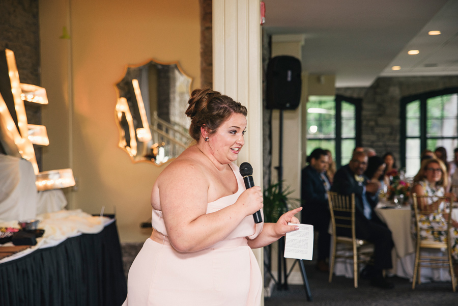 maid of honor delivering a speech to bride and groom