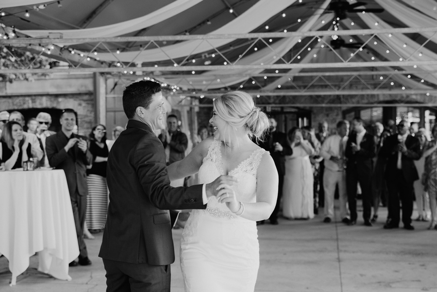black and white of bride and groom during first dance