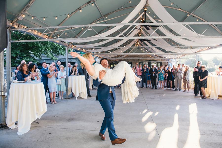 groom lifting bride on the dance floor