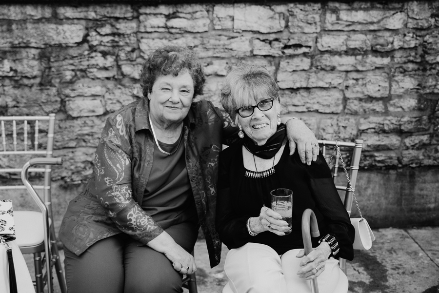 black and white portrait of two elderly wedding guests