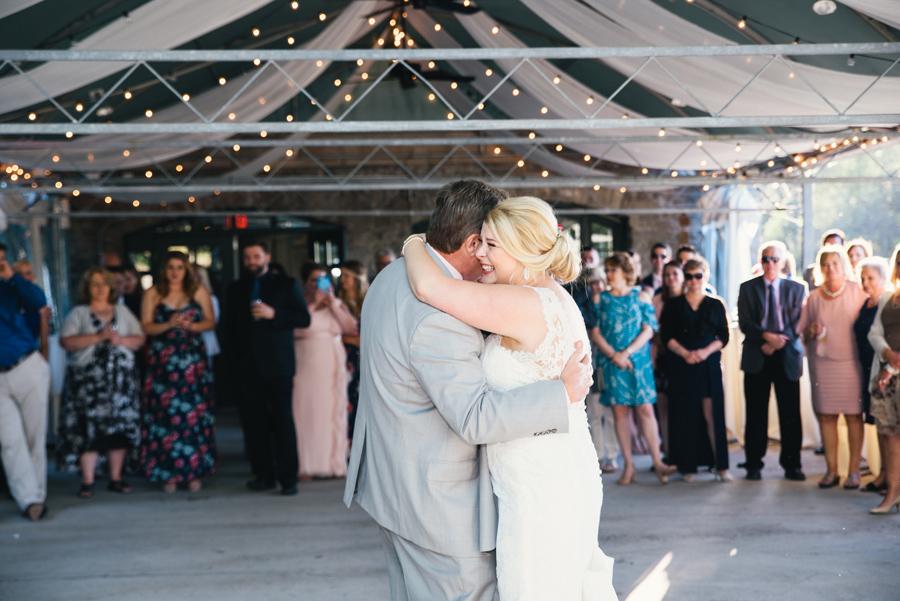 bride hugging her father on the dance floor