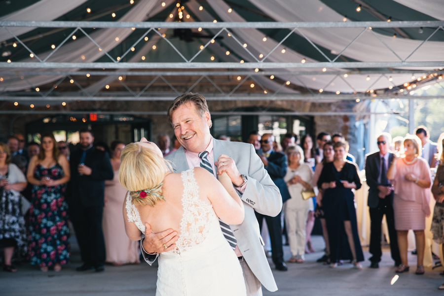 bride and her father laughing during father daughter dance