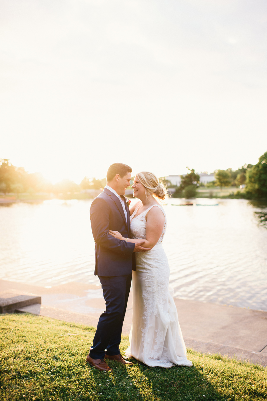 portrait of bride and groom smiling at each other at sunset